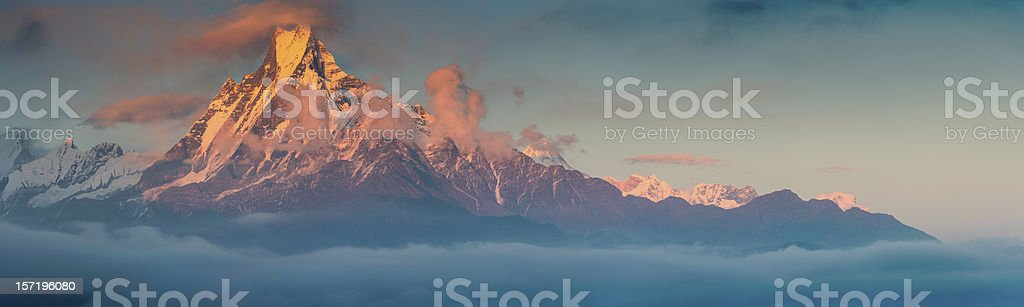 Golden mountain sunset Machapuchare sacred Himalaya peak stock photo