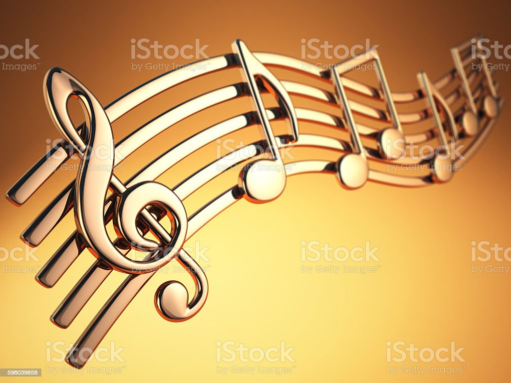 Golden music notes and treble clef on musical strings stock photo