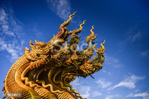 Golden Naga statue at Golden Temple. A beautiful Temple in Thailand name Wat Sri Pun Ton, Nan province, Thailand.