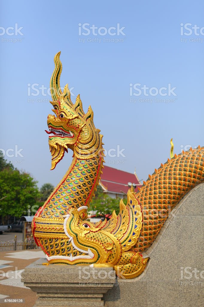 Golden naga statue at the temple stairs, The great serpent guardian of Buddha, wat Podhisomborn, Udon Thani, Thailand stock photo