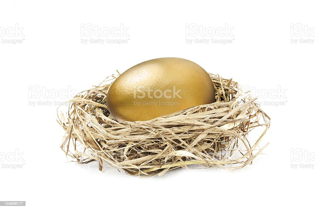 golden nest egg isolated on white royalty-free stock photo