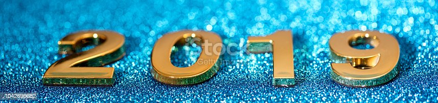 1018011484 istock photo Golden New Year 2019 on a sparkling background (blue) 1042696682