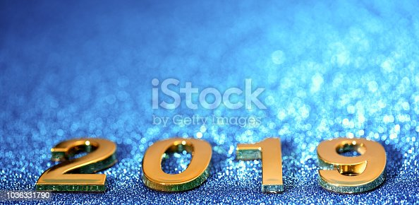 1018011484 istock photo Golden New Year 2019 on a sparkling bokeh background (blue) 1036331790
