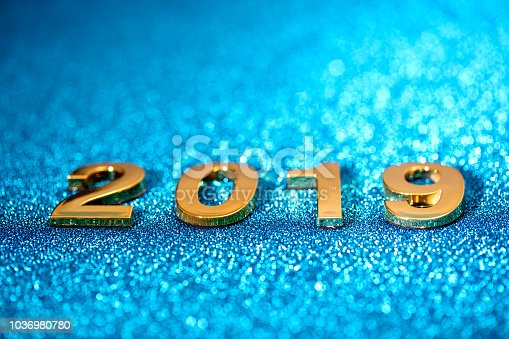 1018011484 istock photo Golden New Year 2019 on a sparkling bokeh background (blue) 1036980780
