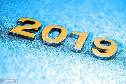 1018011484 istock photo Golden New Year 2019 on a sparkling defocused background (blue) 1069079376