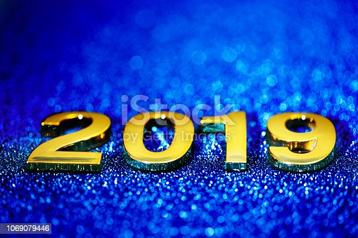 1018011484 istock photo Golden New Year 2019 on a sparkling defocused background (blue) 1069079446
