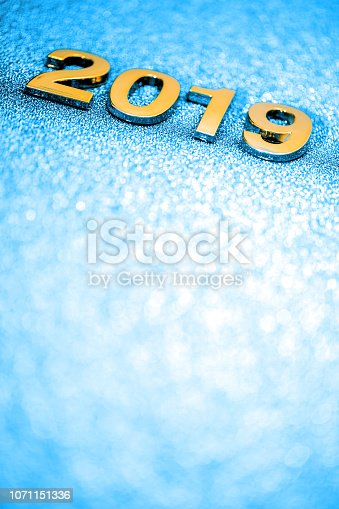1018011484 istock photo Golden New Year 2019 on a sparkling defocused background (blue) 1071151336