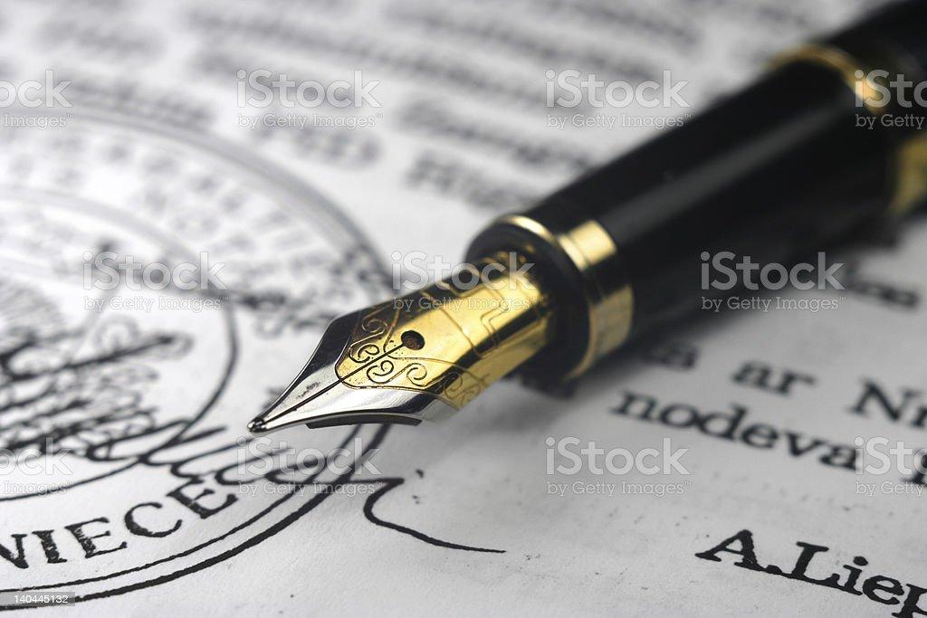 Golden nib pen on document stock photo