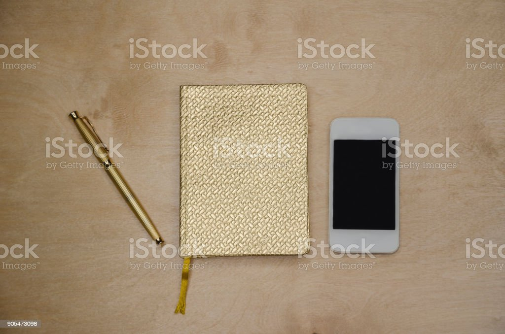 golden notepad for notes stock photo