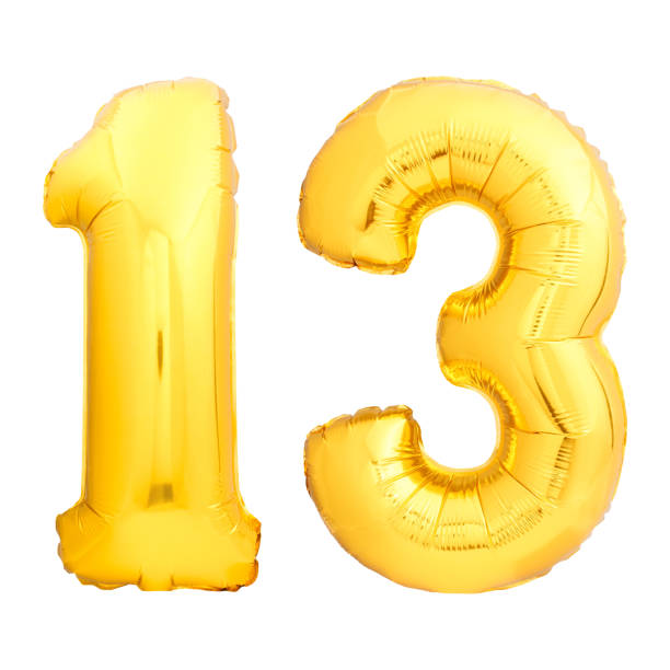 Golden number 13 made of inflatable balloon stock photo