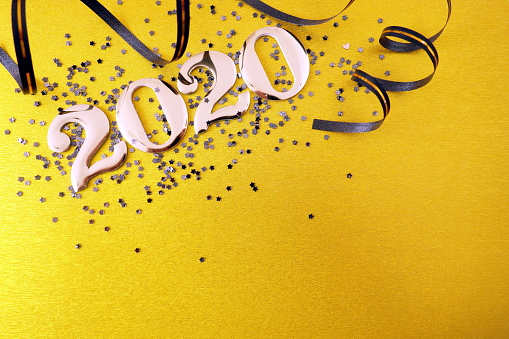istock Golden number 2020 and decorations on yellow background 1171749703
