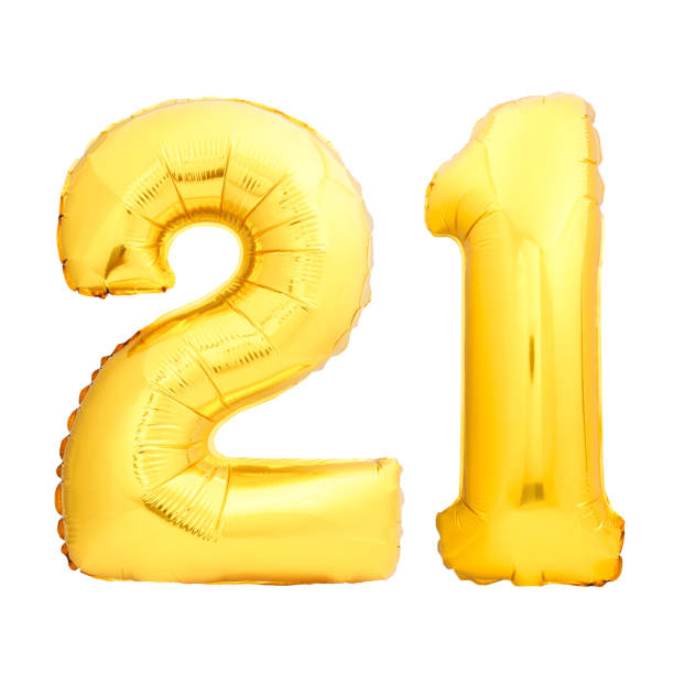 golden number 21 twenty one made of inflatable balloon - number 21 stock photos and pictures