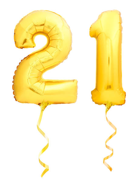 golden number 21 twenty one made of inflatable balloon with ribbon isolated on white - number 21 stock photos and pictures