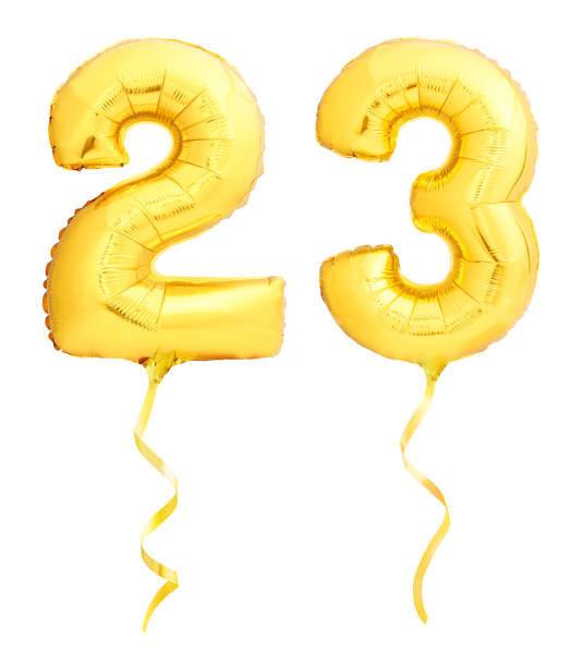 golden number 23 twenty three made of inflatable balloon with ribbon isolated on white - number 23 stock photos and pictures