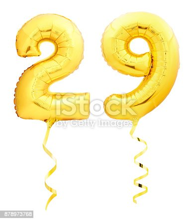 927069242 istock photo Golden number 29 twenty nine made of inflatable balloon with ribbon isolated on white 878973768