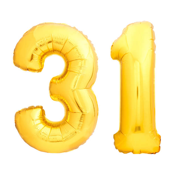 Golden number 31 thirty one made of inflatable balloon stock photo
