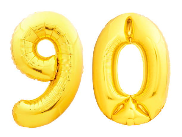 golden number 90 ninety made of inflatable balloon - number 90 stock photos and pictures