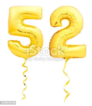 927069242 istock photo Golden number fifty two 52 made of inflatable balloon with ribbon on white 878978156