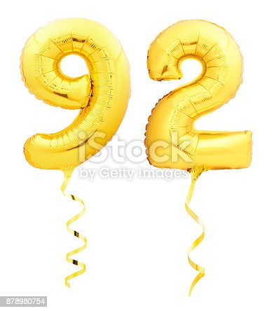 927069242 istock photo Golden number ninety two 92 made of inflatable balloon with ribbon on white 878980754