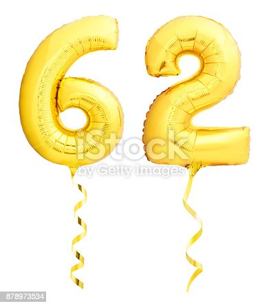 927069242 istock photo Golden number sixty two 62 made of inflatable balloon with ribbon on white 878973534