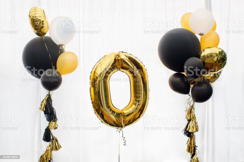 Golden number zero balloon stock photo