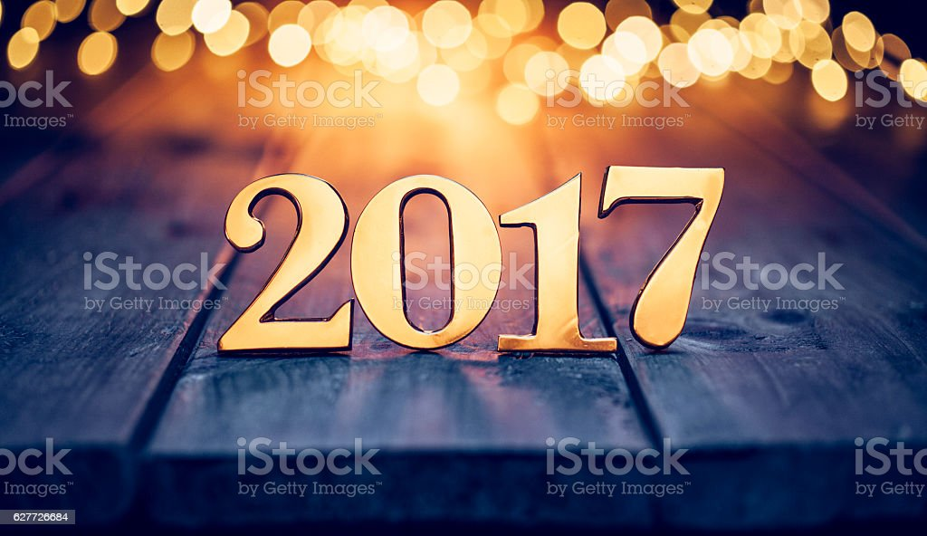Golden numbers 2017 - Christmas Lights Wood New Year Gold stock photo
