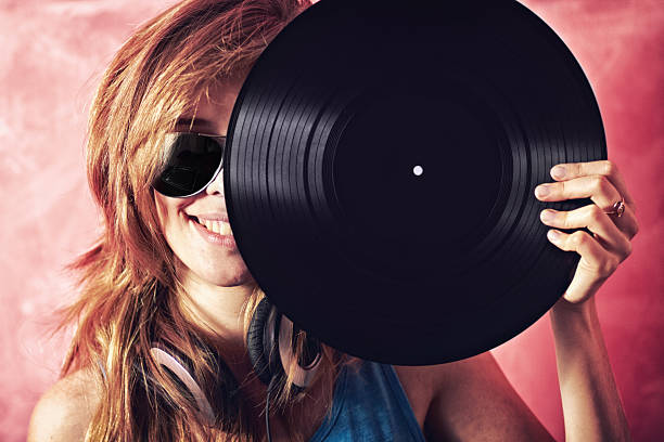 Golden Oldies are still the best Fun portrait of a young woman holding a vinyl record up to her facehttp://195.154.178.81/DATA/shoots/ic_781190.jpg electronic music stock pictures, royalty-free photos & images