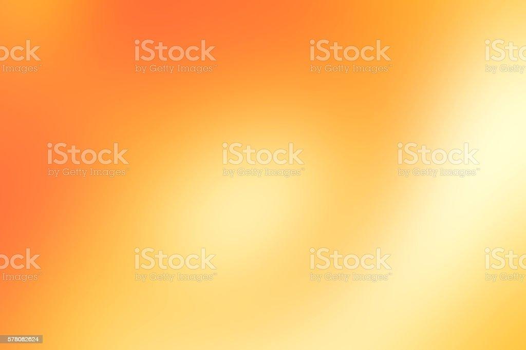 Golden orange colored blurred background stock photo
