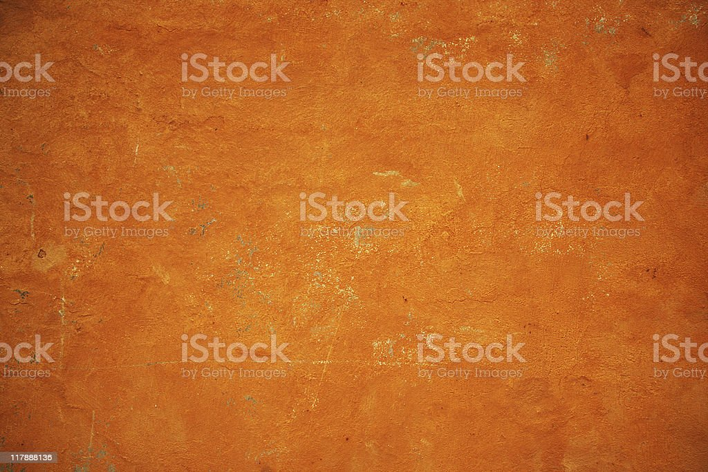 Golden orange grunge wall texture stock photo