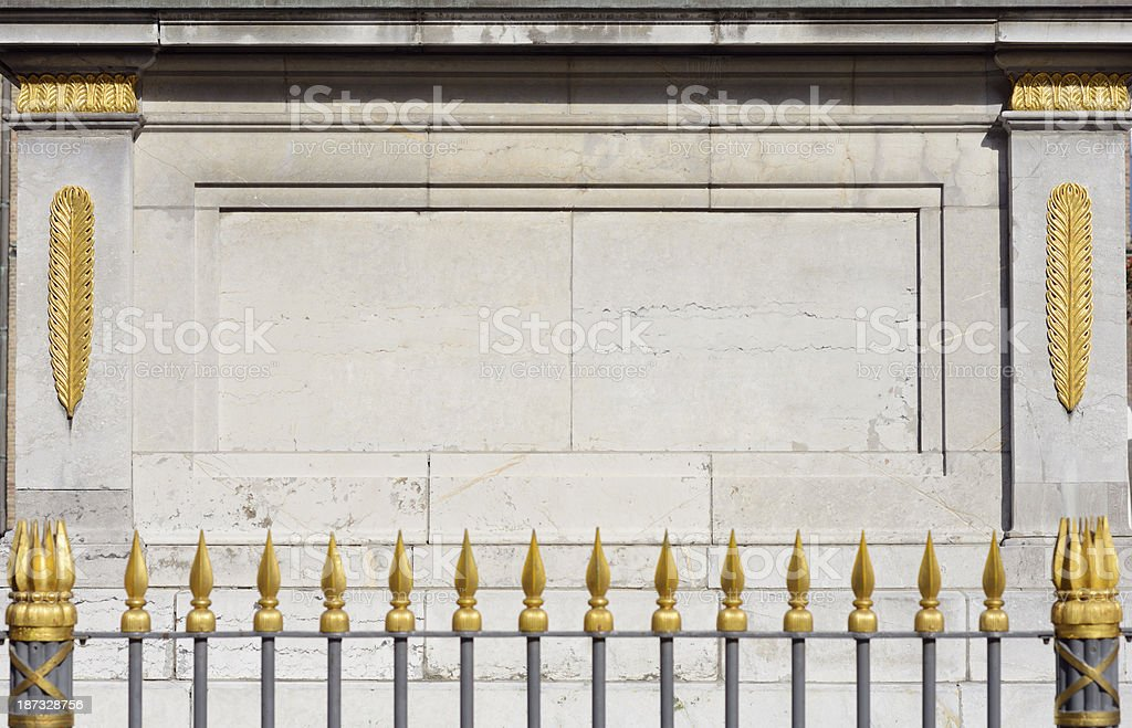 Golden ornaments and fence royalty-free stock photo