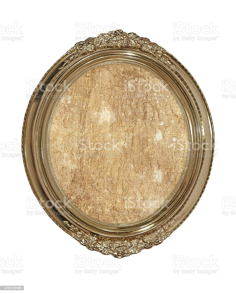 Golden oval photo frame with old brown canvas inside.Isolated. royalty-free stock photo