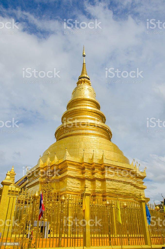 golden pagoda  at lamphun,thailand stock photo