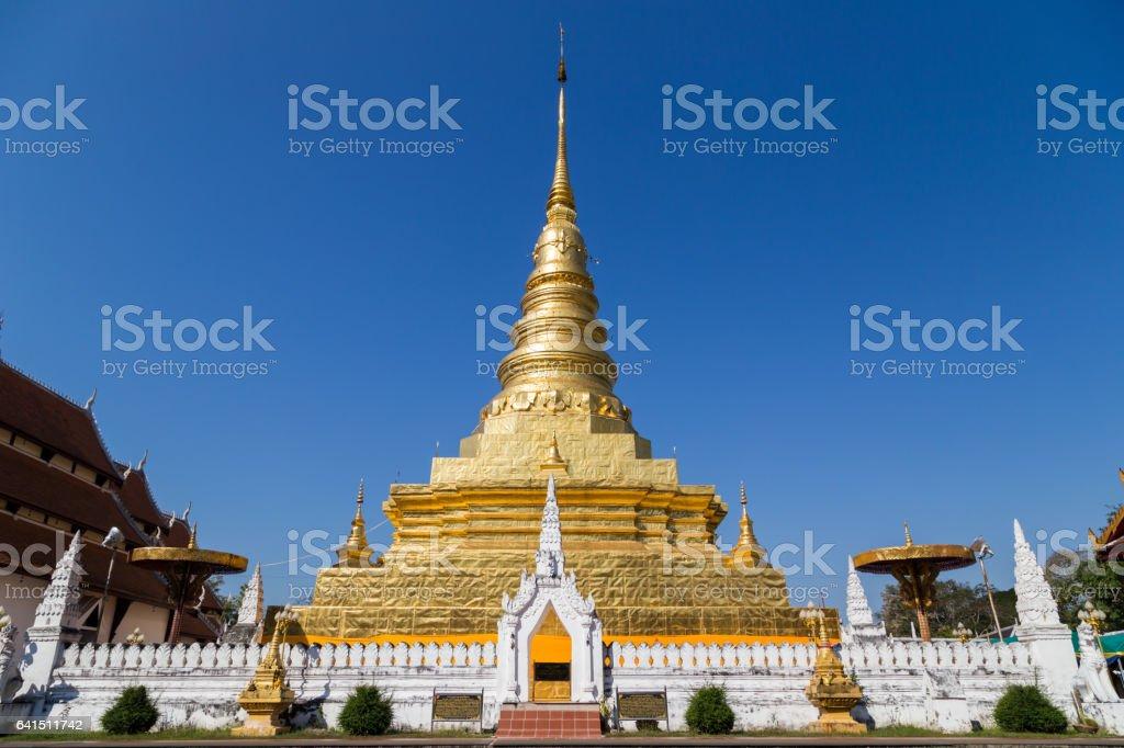 golden pagoda at wat phra that chae haeng temple stock photo