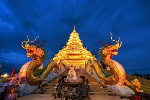 istock Golden Pagoda nine tier with dragon texture at Chinese temple - wat hyua pla kang , Chiang Rai,northern of Thailand 917535214