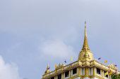 Golden pagoda on Slate gray sky ,Wat Saket Ratcha Wora Maha Wihan, Bangkok, Thailand.