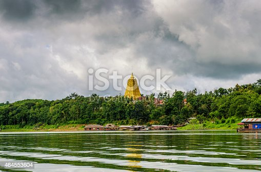 909806032istockphoto golden pagona near a village and river 464553604