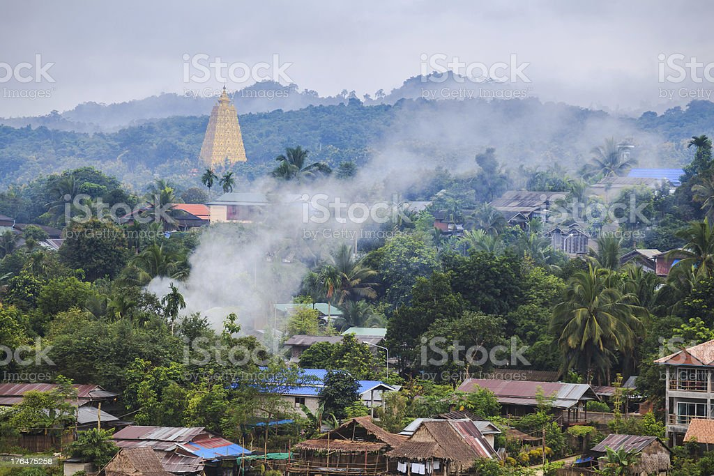 Golden pagpda and the morning mist at sangklaburi, thailand royalty-free stock photo