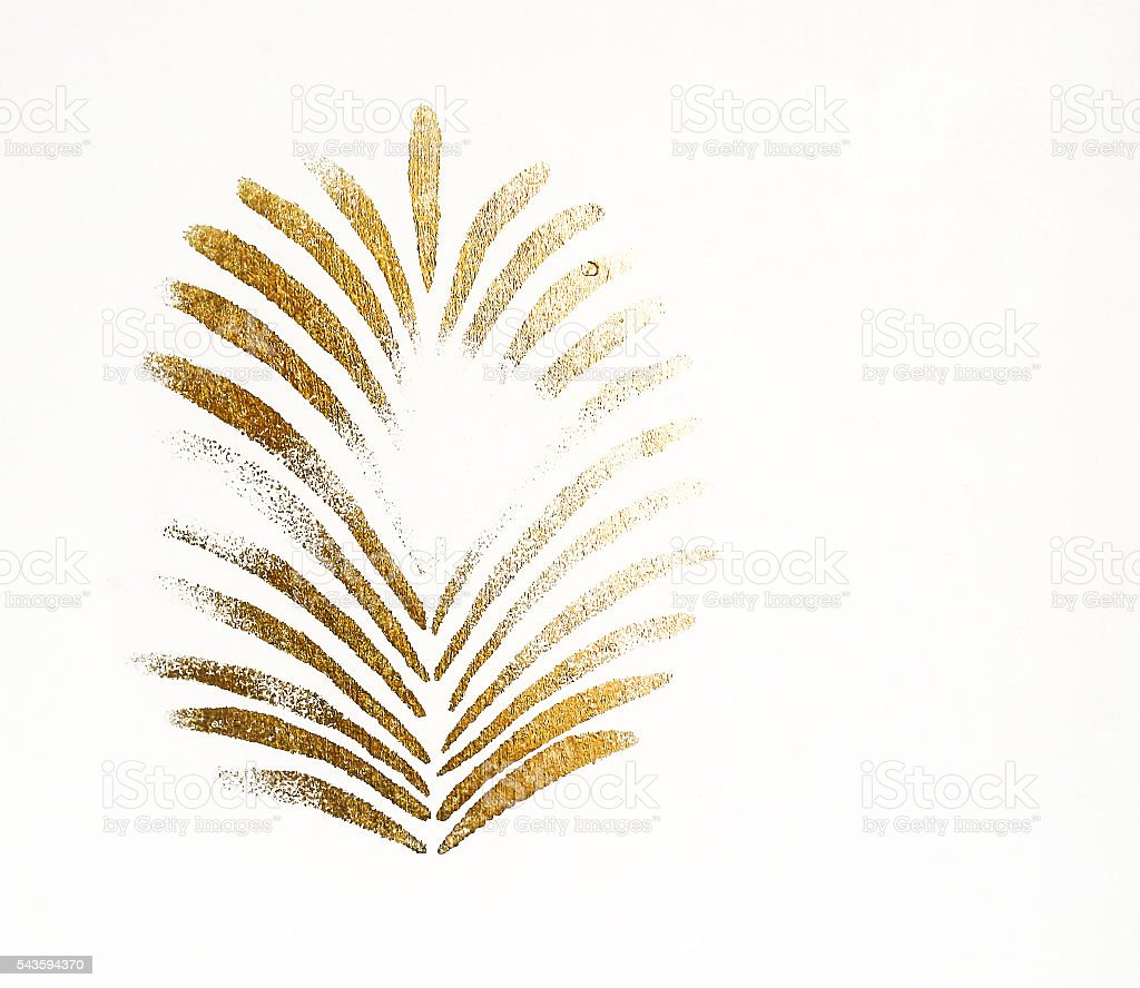 Golden palm leaf print on stucco. stock photo