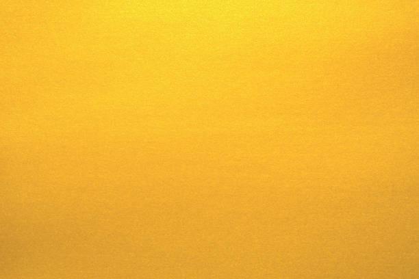 goldene papierstruktur für hintergrund - glitter farbige wände stock-fotos und bilder