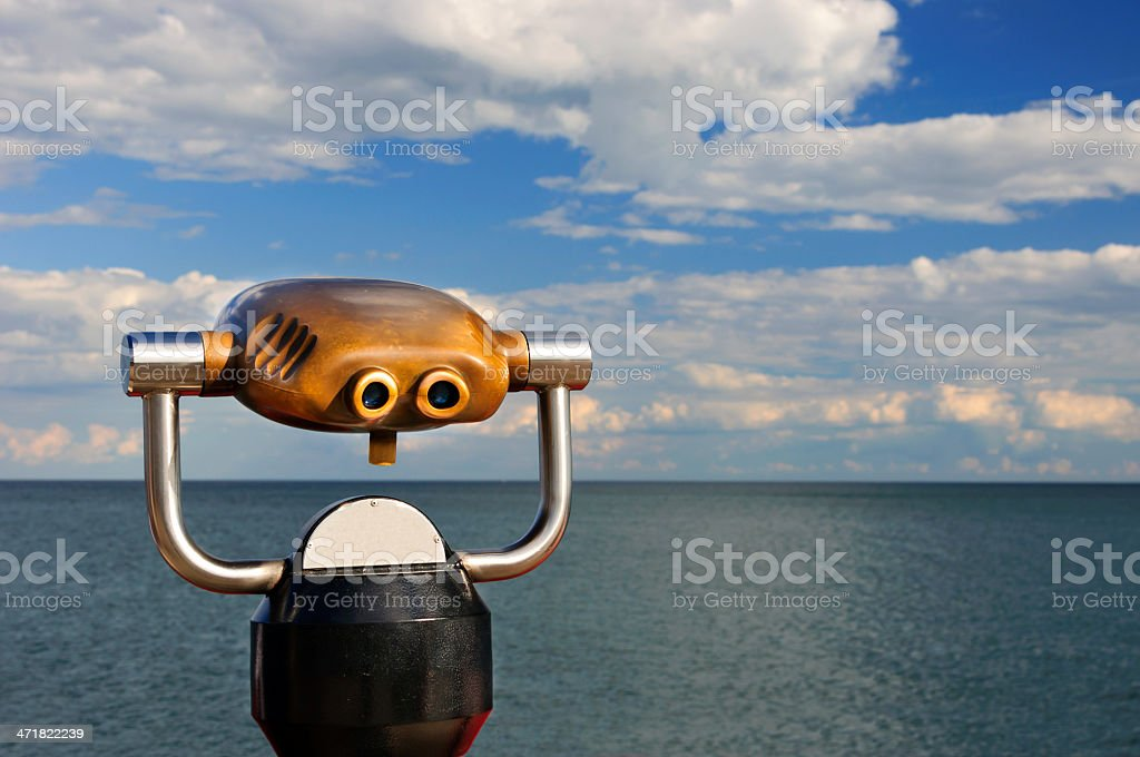 Golden pay binoculars in a Public Area royalty-free stock photo