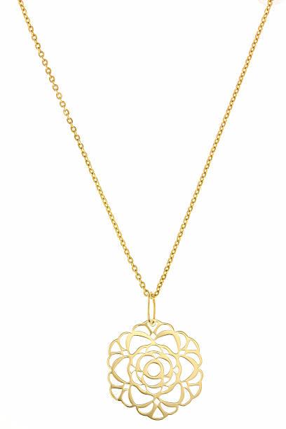 golden кулоном изолированный на белом - ожерелье стоковые фото и изображения