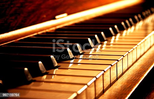 Wood piano in dramatic gold tones