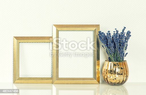 istock Golden picture frame and lavender flowers. Vintage style mockup. 482447456