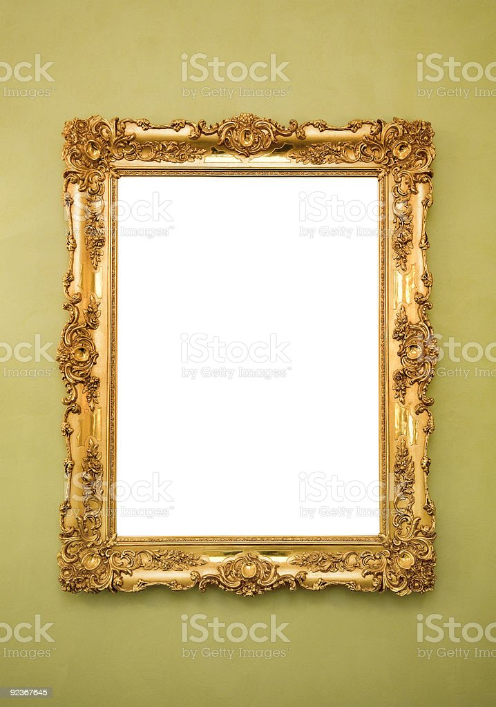 A golden picture frame with an empty canvass stock photo