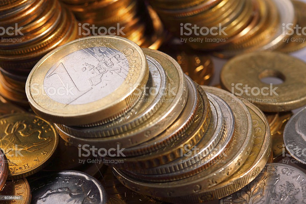 golden piles of coins closeup royalty-free stock photo