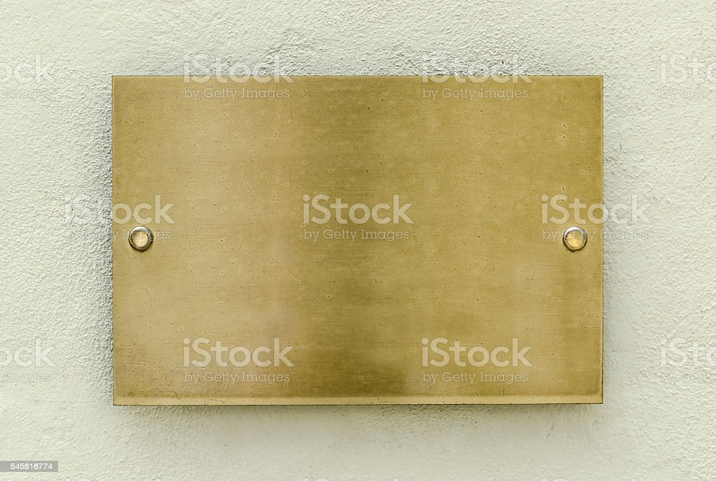 Golden plaque stock photo