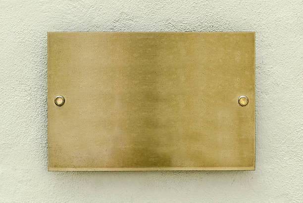 golden plaque - messing stockfoto's en -beelden