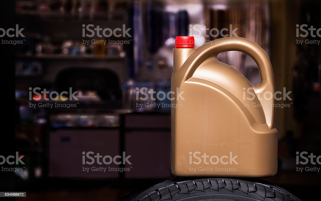 Golden  plastic canister stock photo