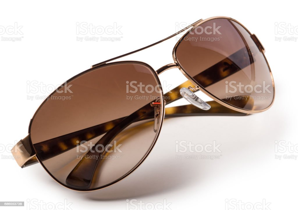 Golden plated brown sunglasses isolated on white background ロイヤリティフリーストックフォト