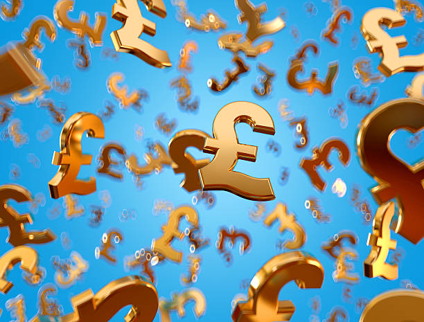Golden pound sterling signs raining. Golden pound sterling signs falling on the blue background. british currency stock pictures, royalty-free photos & images